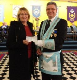 Presentation of cheque from the Freemasons